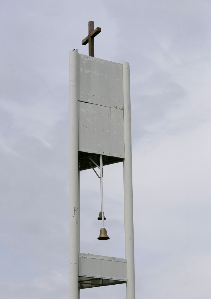 This cellphone tower inside the bell tower is seen over the Resurrection Lutheran Church in Ankeny, Iowa. As wireless companies fill gaps in their networks, many have sought to camouflage the ungainly outdoor equipment that carries the nation's daily diet of calls, text messages and data.