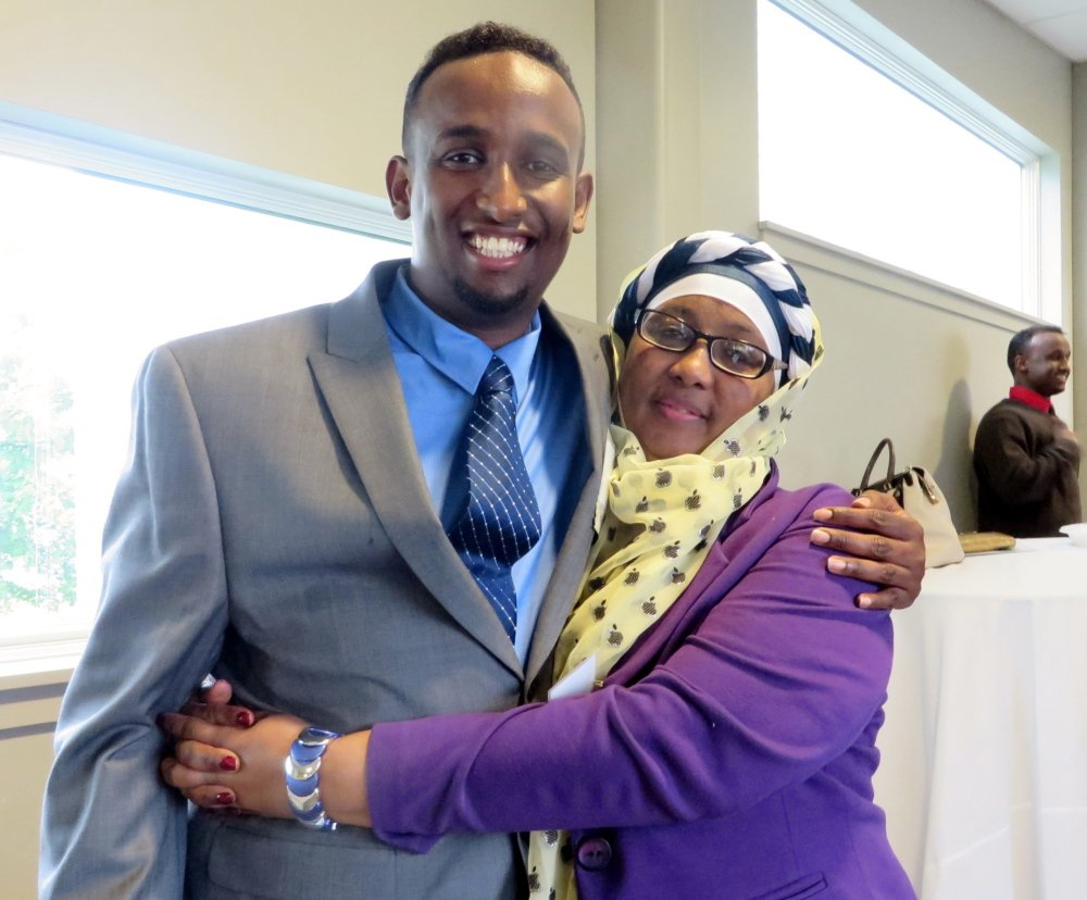 Sharmarke Hussain Ali, honored as the Opportunity Alliance Resident Leader of the Year for creating an after-school program for students with language barriers, with his mother Roda Noor of Portland.