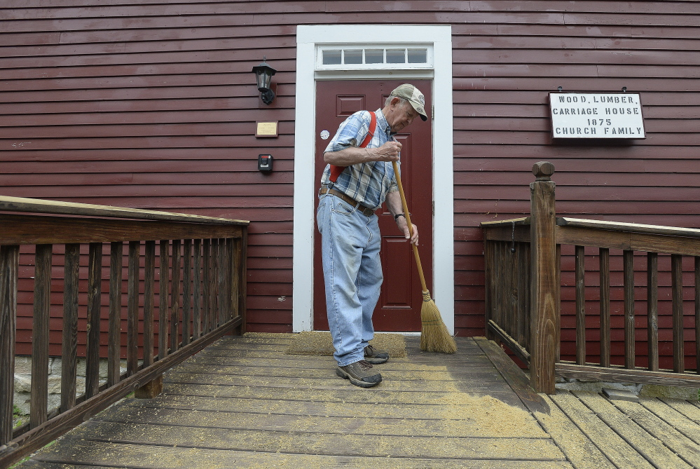 Volunteer Alfred Carlson, a member of Friends of the Alfred Shaker Museum, sweeps the front steps at the museum. Shawn Patrick Ouellette/Staff Photographer