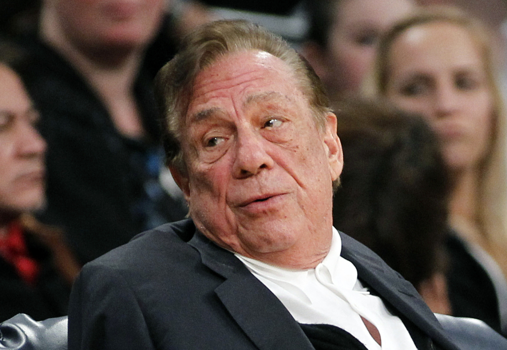 In this December 2011 file photo, Los Angeles Clippers owner Donald Sterling watches the Clippers play the Los Angeles Lakers. Sterling's team of lawyers has hired four private investigation firms to dig up dirt on the NBA's former and current commissioners and its 29 other owners, said a person familiar with Sterling's legal strategy.