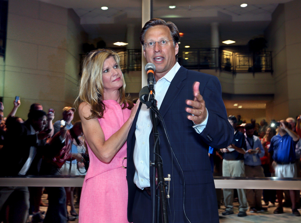 Dave Brat, stands his wife, Laura, as he speaks to supporters after defeating Republican Congressman Eric Cantor in the Republican primary for the 7th Congressional District in Virginia on Tuesday.