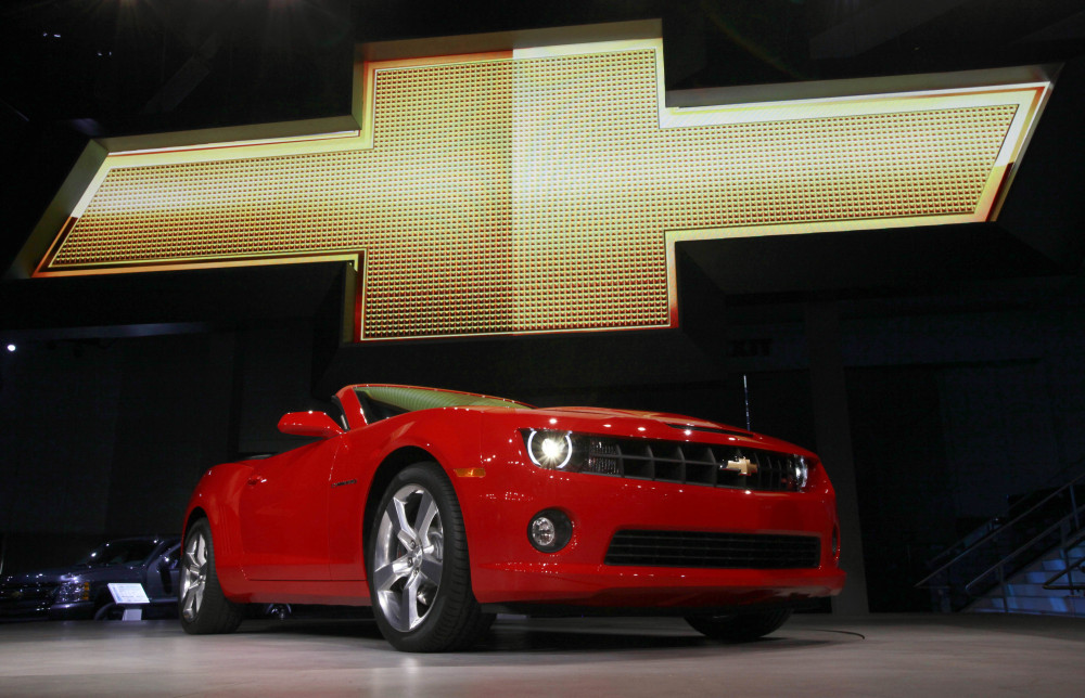 "The 2011 Chevrolet Camaro convertible is shown at its debut at the Los Angeles Auto Show in November 2010. General Motors is recalling nearly 512,000 Chevrolet Camaro cars from the 2010 to 2014 model years. A driver's knee can bump the key and knock the switch out of the ""run"" position, causing an engine stall."