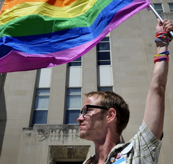 Gary Jones of Racine, Wis., holds a gay-pride flag in front of the Racine County Courthouse on Friday.