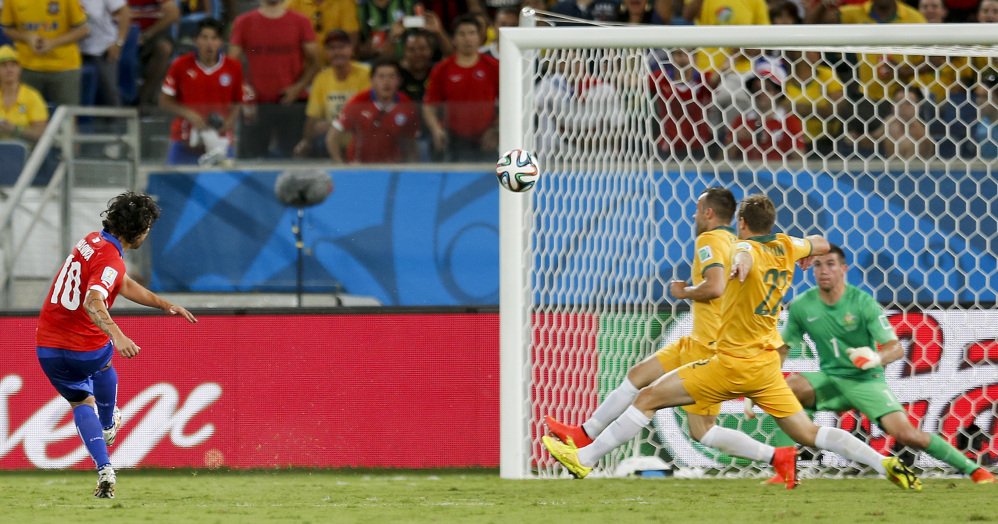 Chile's Jorge Valdivia scores his side's second goal during the group B World Cup soccer match between Chile and Australia in the Arena Pantanal in Cuiaba, Brazil, Friday, June 13, 2014.