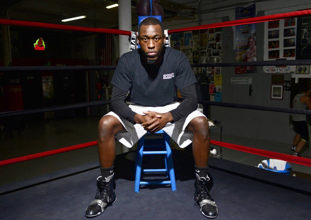 Russell Lamour fights for the New England middleweight title Saturday. He works the graveyard shift at Long Creek Youth Development Center to support his dream of winning a world title.