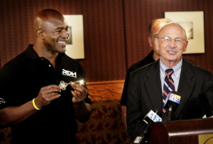 Former heavyweight boxing champion Evander Holyfield shows off the key to the city that was given to him by Portland Mayor Michael Brennan on Friday. Holyfield will attend a series of fights Saturday night at the Portland Expo.