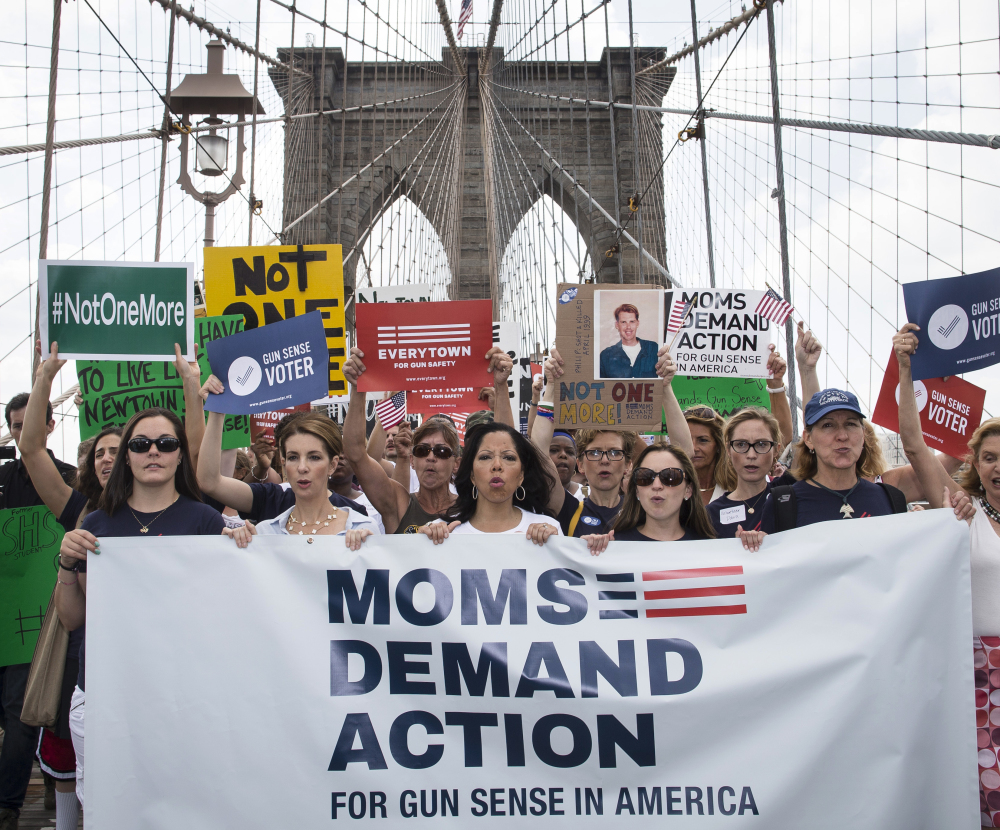 Hundreds of demonstrators march across the Brooklyn Bridge to call for tougher gun control laws Saturday. The protest included relatives of those slain in Newtown, Conn.