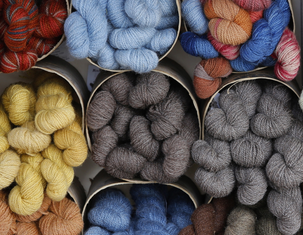 Skeins of yarn from Hope Spinnery create a color-packed display. Derek Davis/Staff Photographer