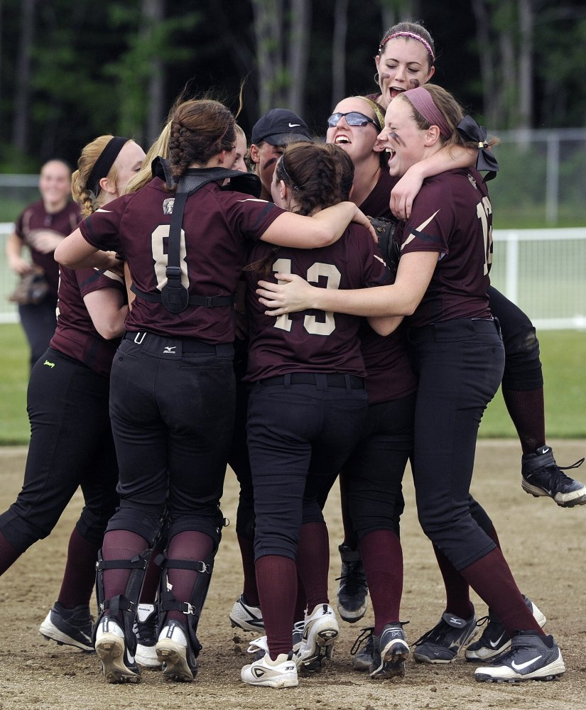Thornton Academy players celebrates after they advanced to the Western Class A softball final with a 10-3 victory Saturday against Cheverus.