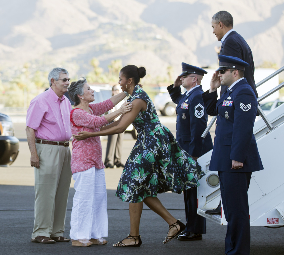 President Barack Obama and first lady Michelle Obama are greeted on the tarmac by Sen. Barbara Boxer, D-Calif., second from left, and her husband, Stewart Boxer, left, on Friday in Palm Springs, Calif.