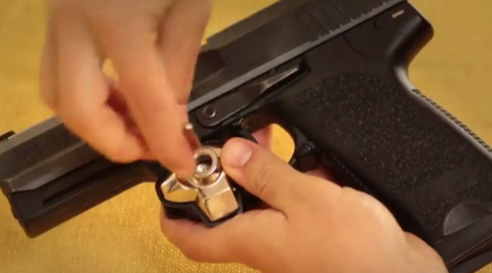 A Maine nonprofit is giving away gun trigger locks like this one, distributing 5,000 of the devices at no charge through police departments around Maine.