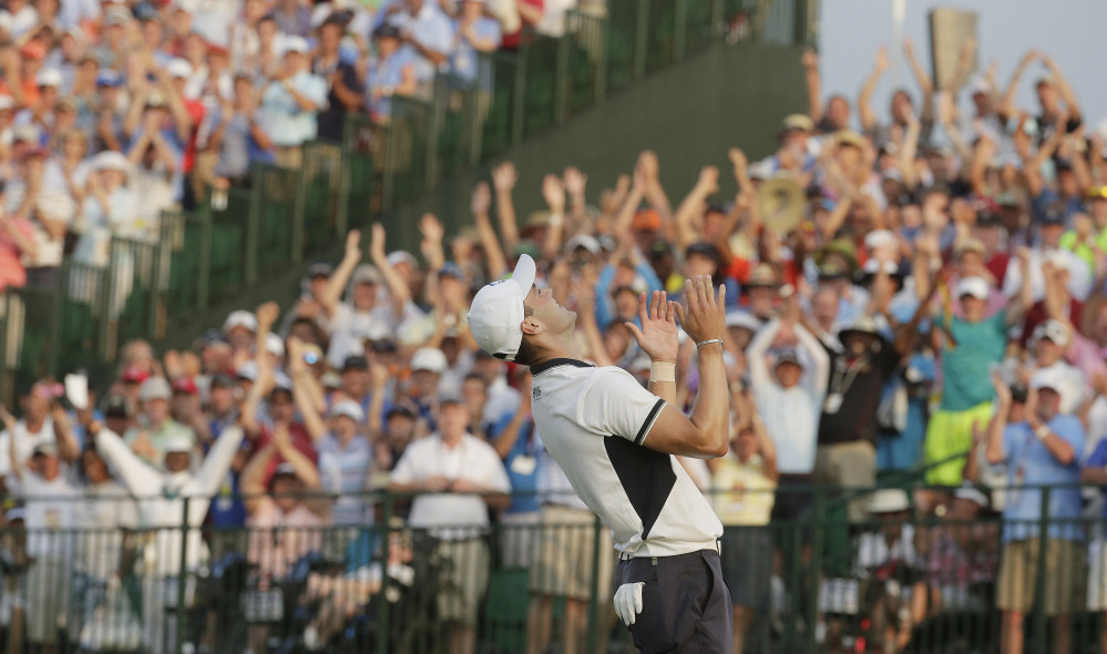 Martin Kaymer, of Germany celebrates after winning the U.S. Open golf tournament in Pinehurst, N.C., Sunday.