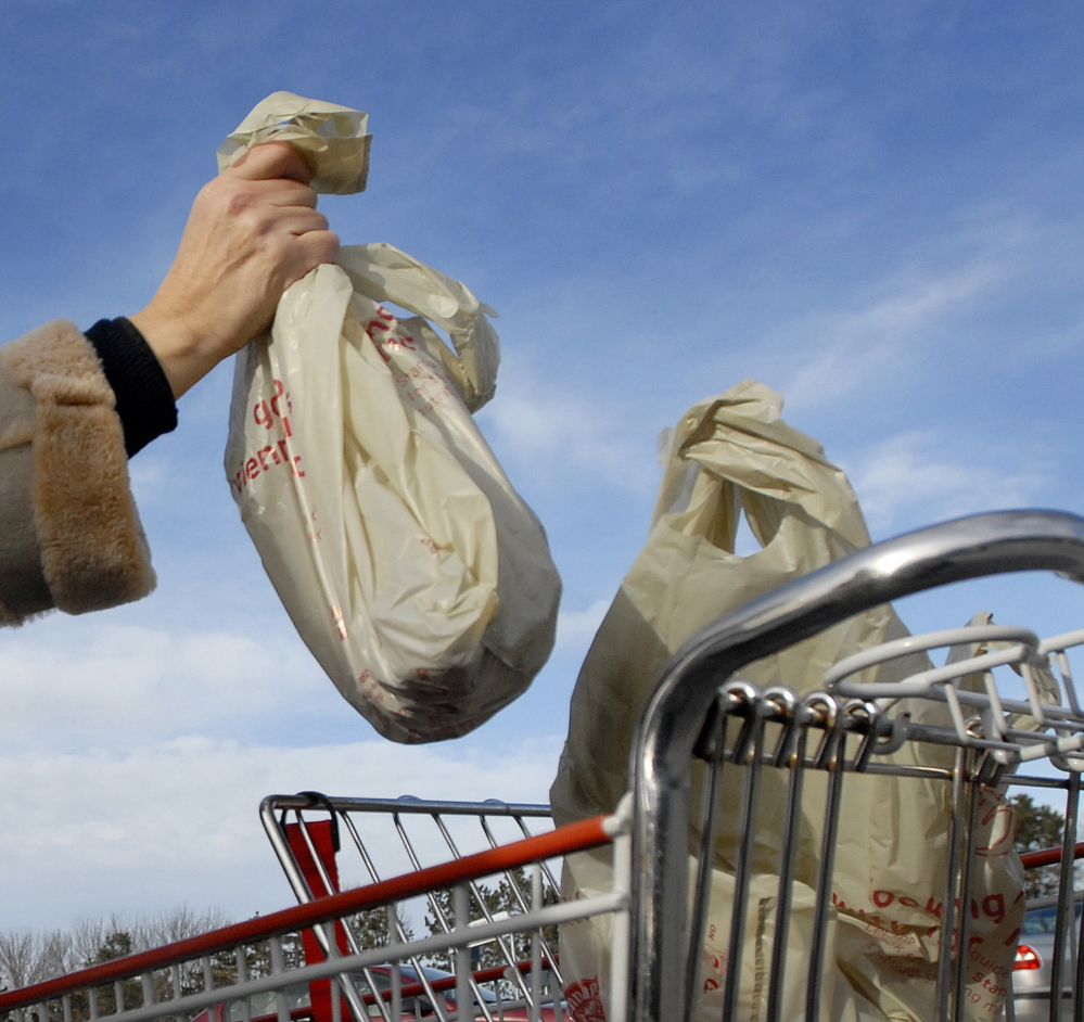 A plan before Portland councilors would require retail stores where food represents 2 percent or more of sales to charge consumers a nickel for each plastic or paper shopping bag they use for their purchases.