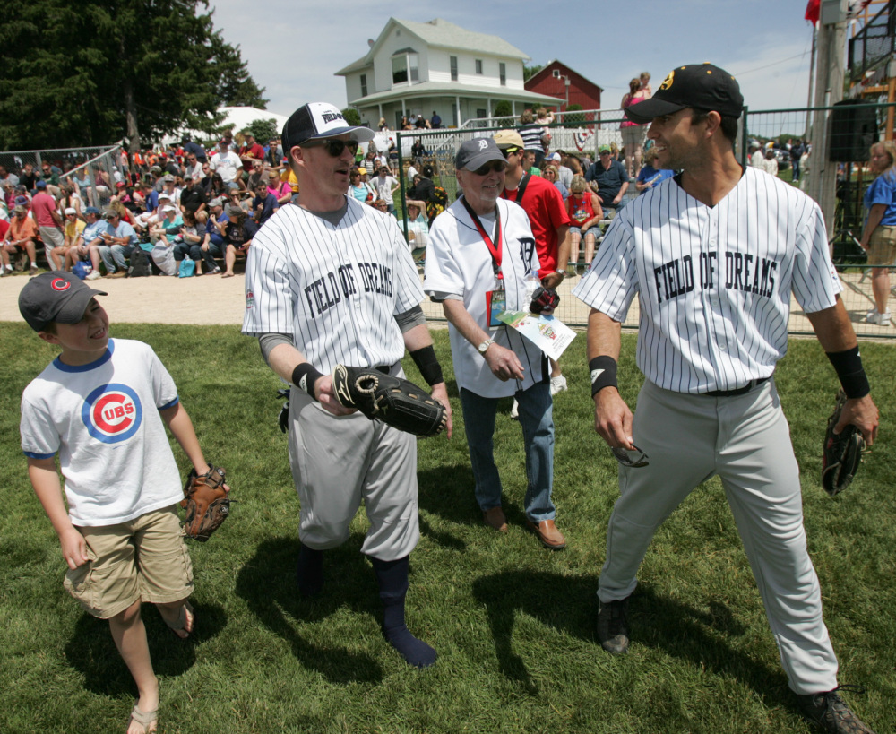Actor Colin Egglesfield, right; his father Bill; brother Sean and nephew Colton arrive for the celebrity softball game Saturday at the Field of Dreams near Dyersville, Iowa.