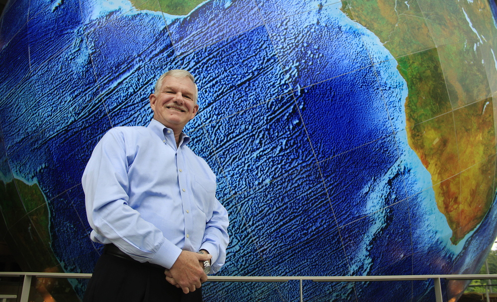 "DeLorme Publishing CEO Michael Heffron, standing near the giant revolving Earth in the window of its Yarmouth headquarters, says ""we're going to protect our reputation"" in the patent case appeal."