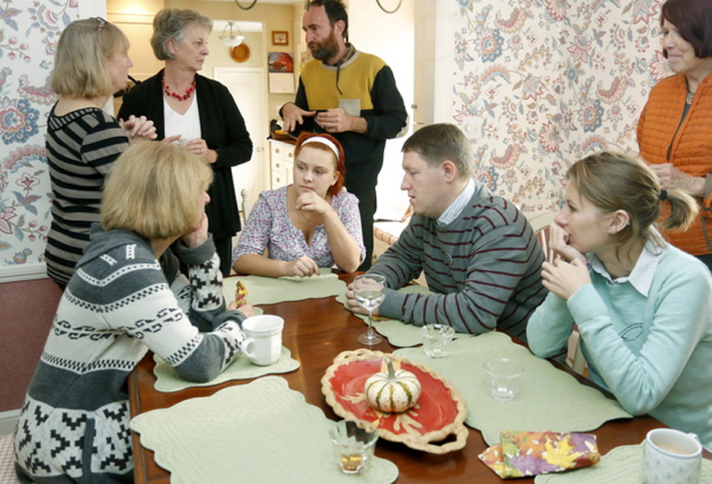 Russian gay-rights activists Lyudmila Romodina, seated middle, and Oleg Klyuenkov, seated right, visit in Cape Elizabeth in 2013 with members of P-FLAG, a group that supports gay and lesbian children.