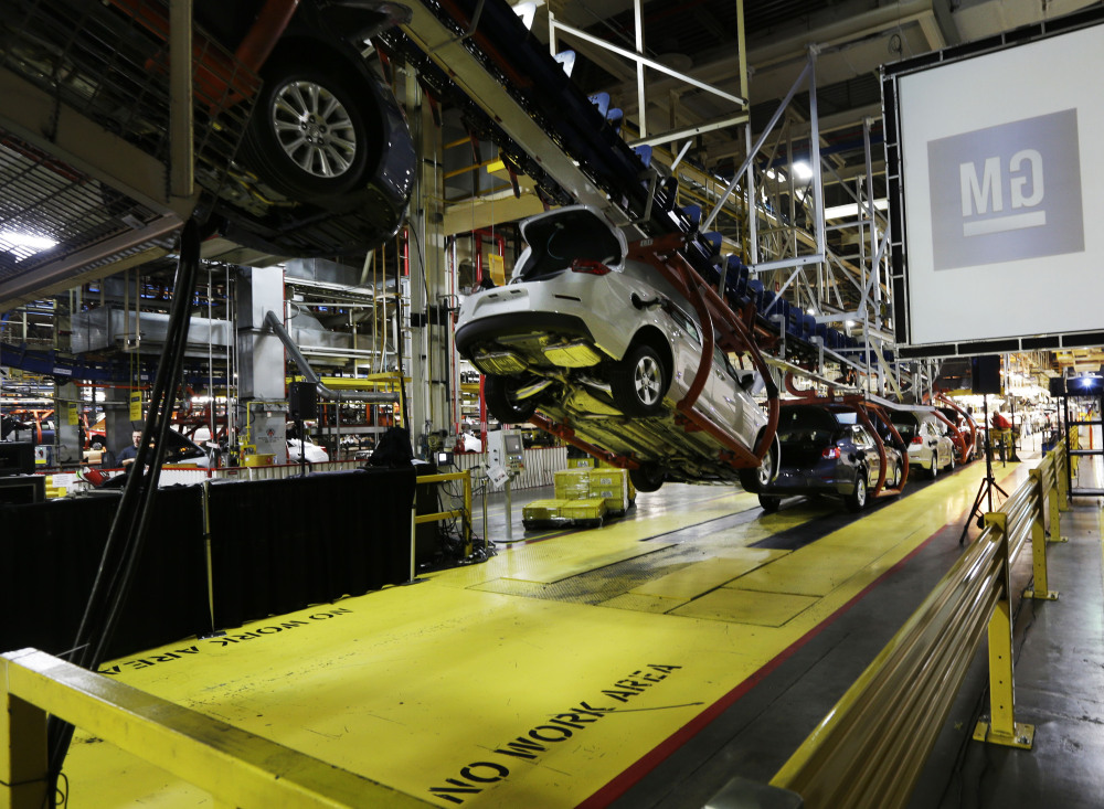 In this Monday, Jan. 28, 2013 file photo, cars move along an assembly line at the General Motors Fairfax plant in Kansas City, Kan.