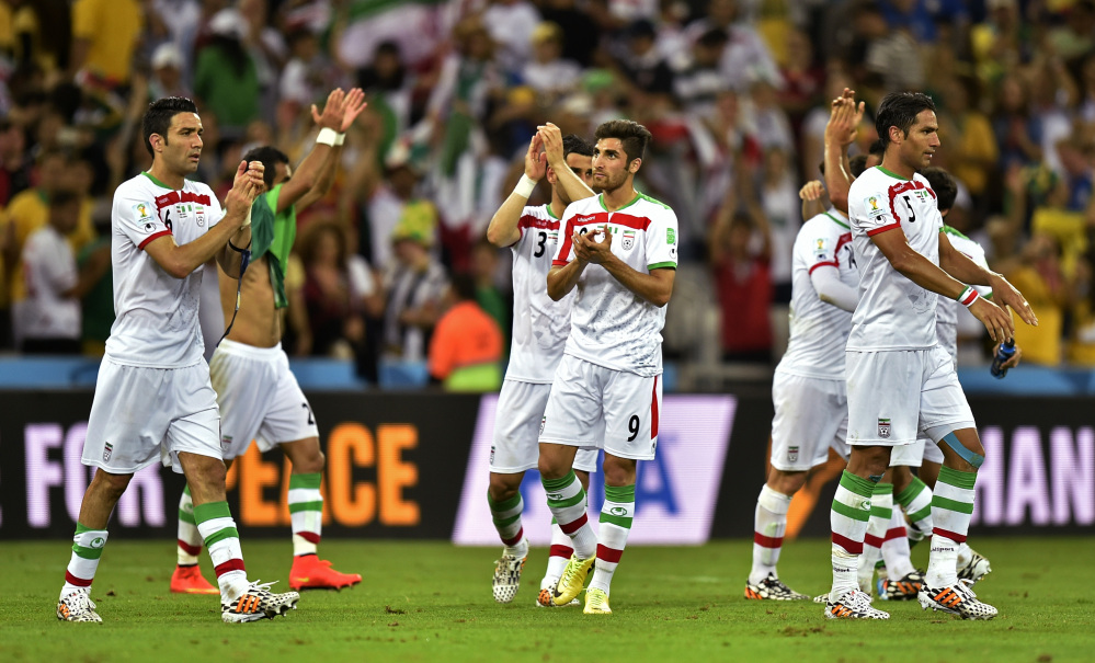 Iranian players applaud the crowd after the group F World Cup soccer match between Iran and Nigeria at the Arena da Baixada in Curitiba, Brazil, Monday, June 16, 2014. The match ended in a 0-0 draw.