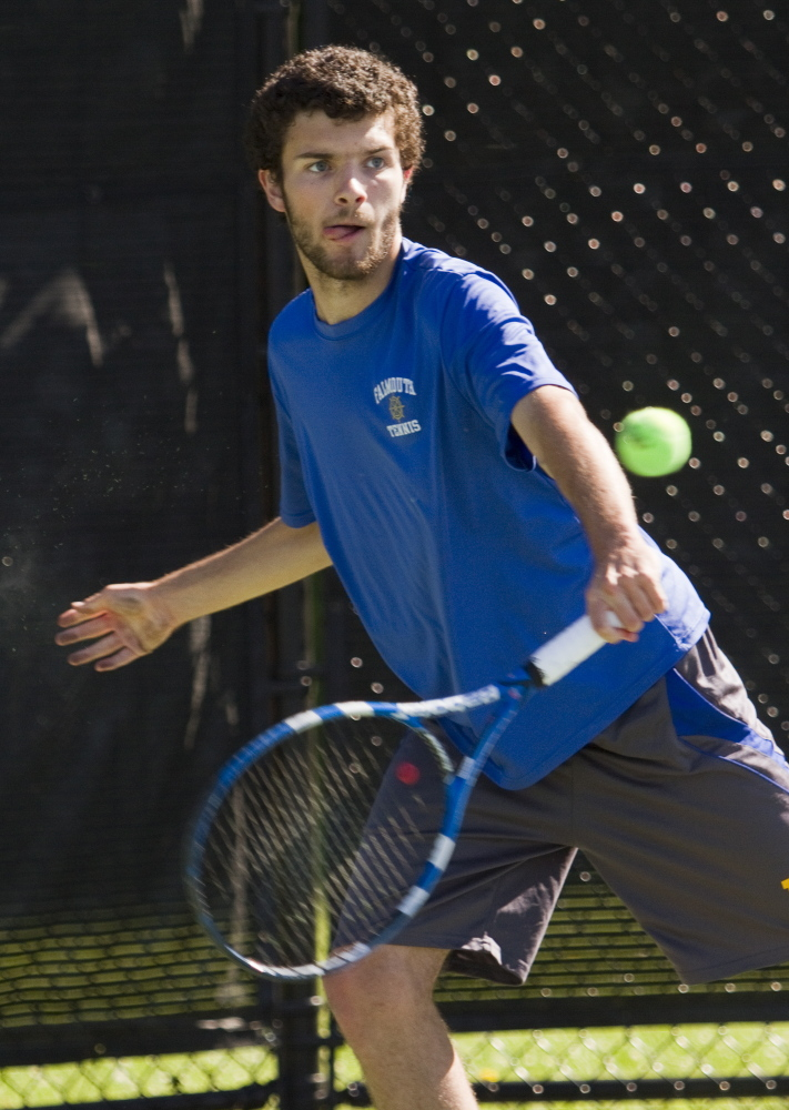 Falmouth's Ben Aicher returns a Mt. Ararat shot during a doubles match at the Class A tennis state championships at Bates College in Lewiston.
