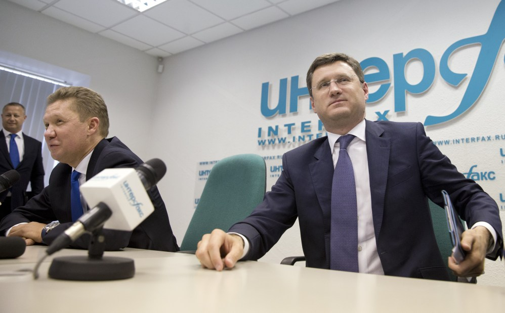 Russia's Energy Minister Alexander Novak, right, listens as Russian state-run natural gas giant Gazprom CEO Alexei Miller speaks at a news conference in Moscow on Monday. Russia on Monday halted gas supplies to Ukraine as a payment deadline passed.