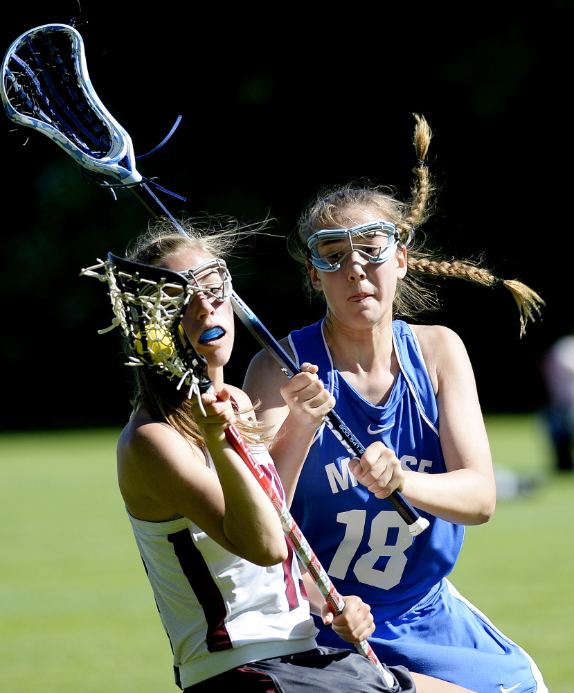 FREEPORT, ME - JUNE 16: Freeport's Courtney Broderick tries to keep the ball from Noa Sreden of Morse in girls lacrosse action Monday, June 16, 2014. (Photo by Shawn Patrick Ouellette/Staff Photographer)