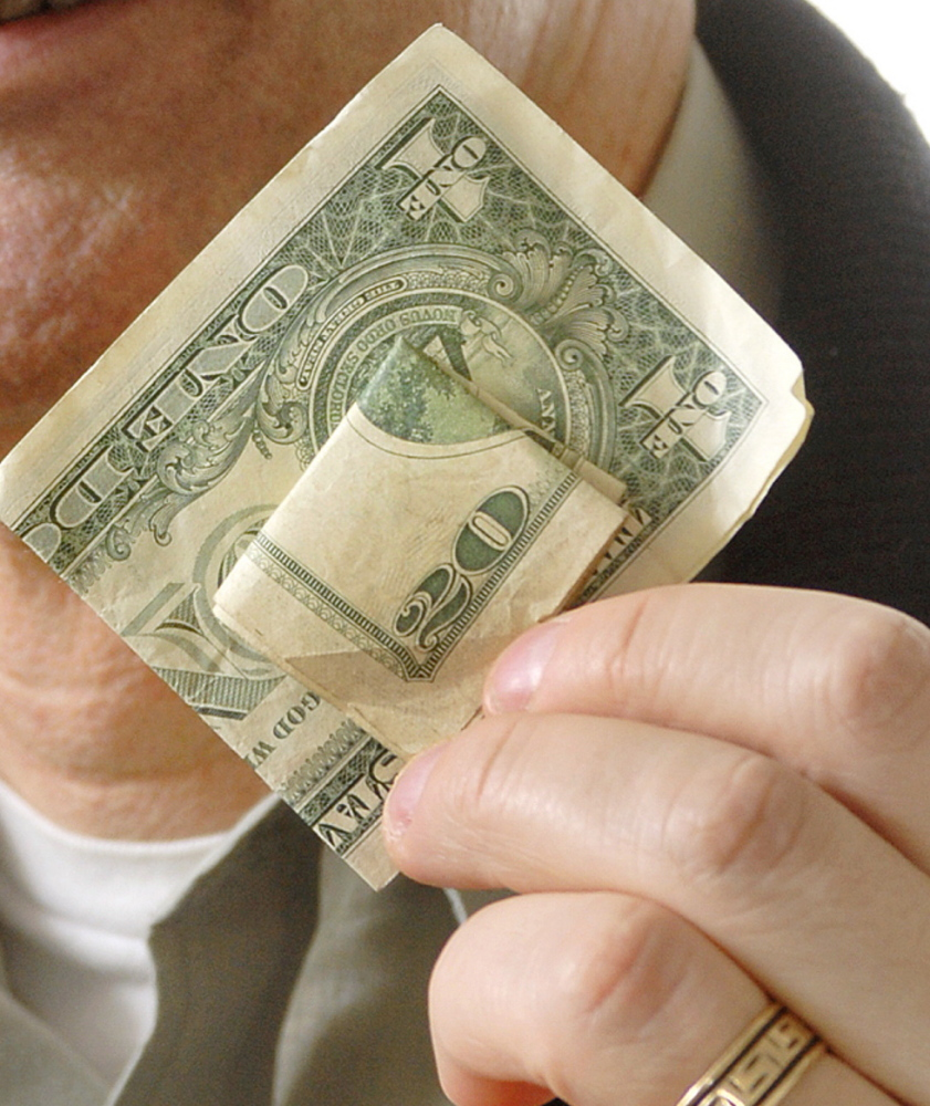 Staff Photo by John Ewing: 20070118 Thursday, January 19, 2007...Ross Doerr, is blind and a staff attorney for  the Disability Rights Center in Augusta, and feels that the U.S. Treasury should change America's paper currency to make it easier for the blind or impaired to distinguish between bill denominations.  Doerr uses a money clip and different folds to differentiate between bill denominations when carrying cash.
