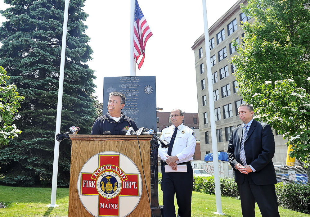 Lt. John Brooks, president of Local 740 of the International Association of Fire Fighters, speaks about the accident that took the life of Capt. Michael Kucsma Tuesday in Portland. To his right are Portland Fire Chief Jerry LaMoria and Police Chief Michael Sauschuck.