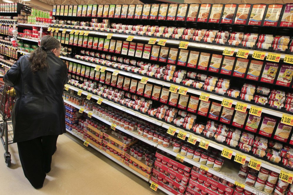 A shopper walks down the canned soup aisle at a grocery store in Cincinnati. Food companies and restaurants could soon face government pressure to make their foods less salty to try to prevent thousands of deaths each year from heart disease and stroke.
