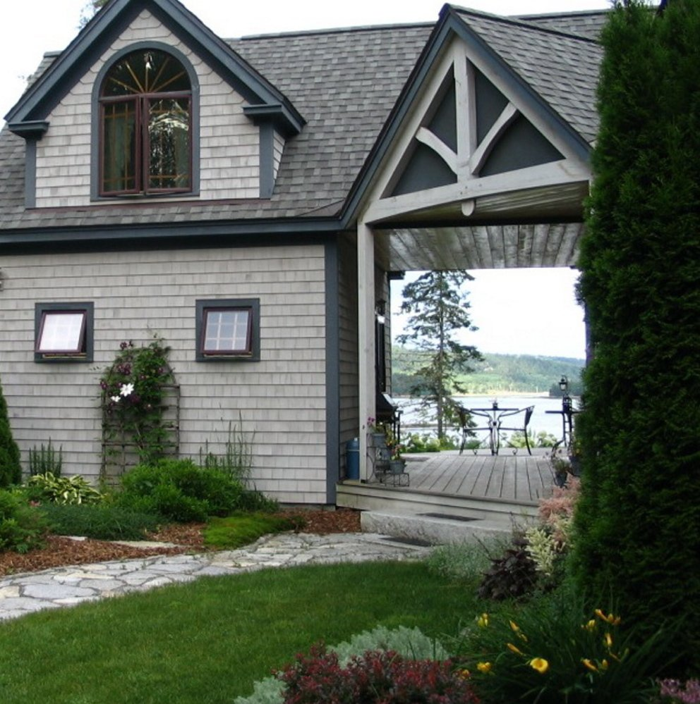 Guests can enjoy a water view with breakfast at Three Pines Bed and Breakfast in Hancock, which is off the grid and home to a chicken flock and organic orchard.