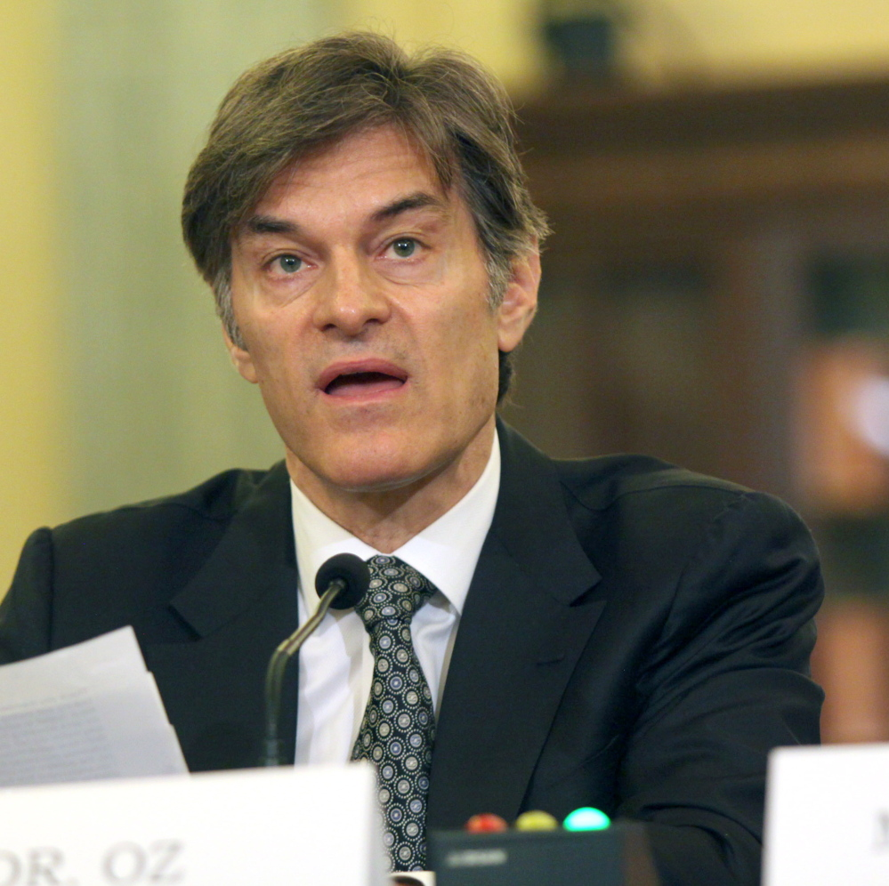 Dr. Mehmet C. Oz, chairman and professor of surgery at Columbia University, testifies on Capitol Hill in Washington on Tuesday about unscrupulous weight-loss advertising.