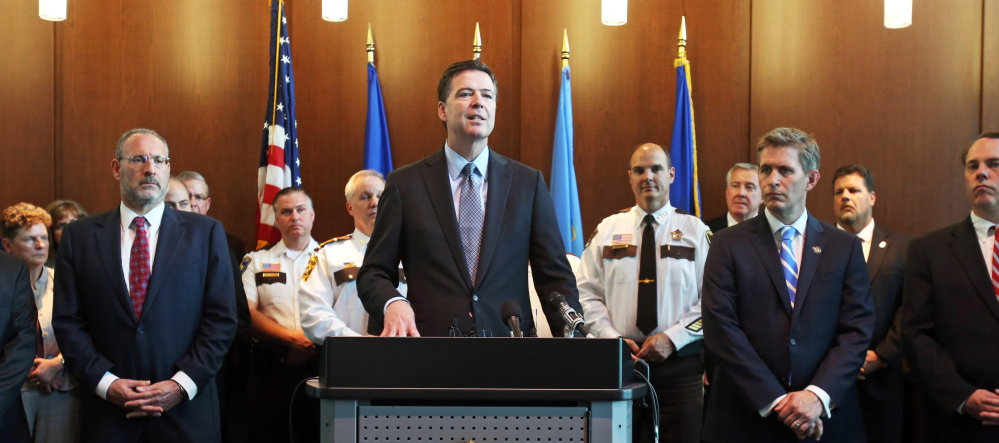 "FBI Director James Comey, backed by law enforcement personnel and prosecutors, said Tuesday the arrest of Ahmed Abu Khattala sends a message to others that ""we will shrink the world to bring you to justice."""
