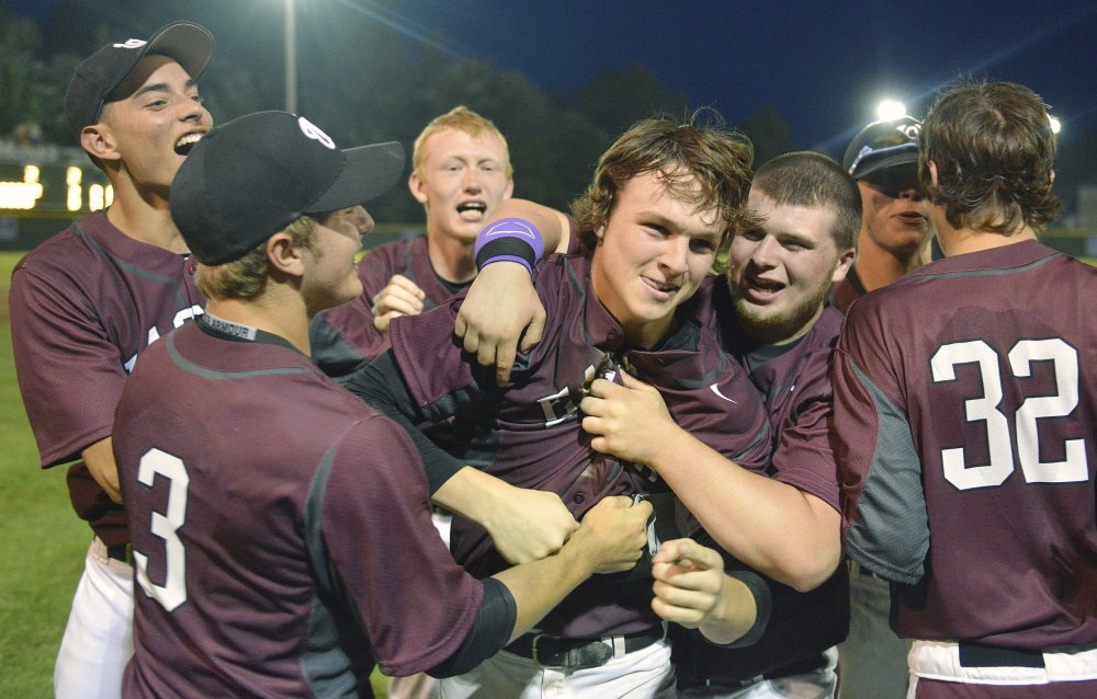 Windham pitcher Tanner Laberge is mobbed by teammates after pitching a no-hitter in the Western Maine Class A final Tuesday in Standish.