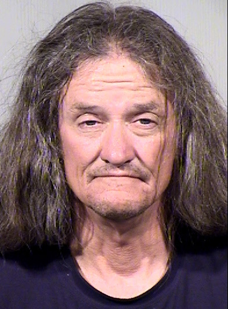 Gary Moran is seen in this June 16, 2014 booking photo provided by the Maricopa County Sheriff's Office. Moran is being held on $1 million bond on suspicion of first-degree murder, burglary and armed robbery, among others charges in the killing of a Roman Catholic priest and the beating of a second priest at a downtown Phoenix church.