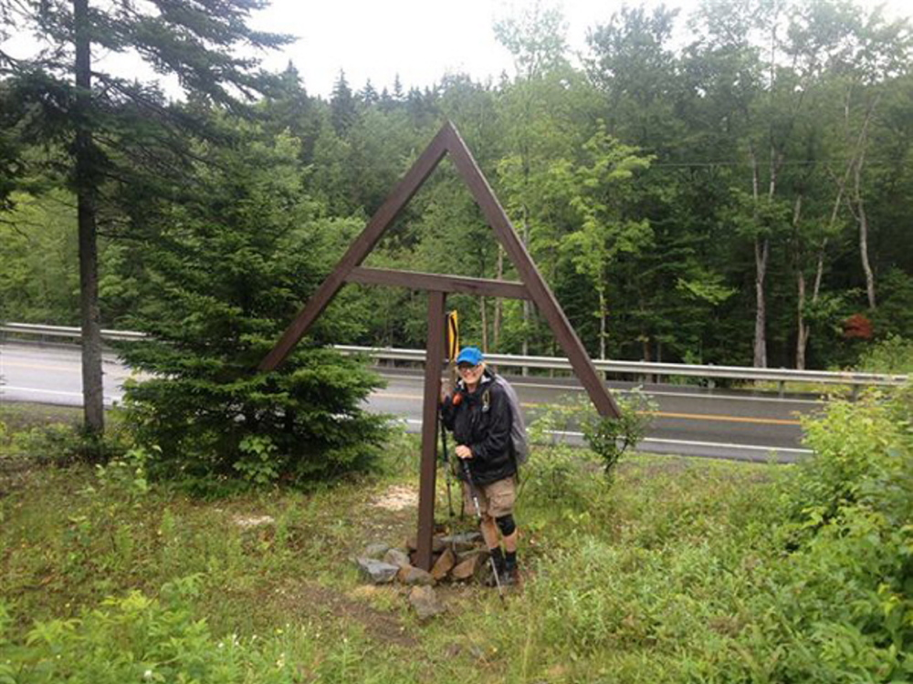 Search: This photo taken Saturday, July 20, 2013, in Sandy River Plantation at the intersection of Route 4 shows Geraldine Largay in the rain jacket that she would likely have been wearing in the rain on Tuesday, July 23.