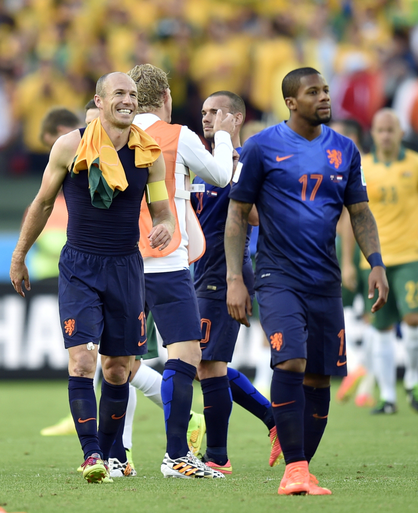 Netherlands' Arjen Robben, left, smiles as he leaves the field after the group B World Cup soccer match between Australia and the Netherlands in Porto Alegre, Brazil, on Wednesday.
