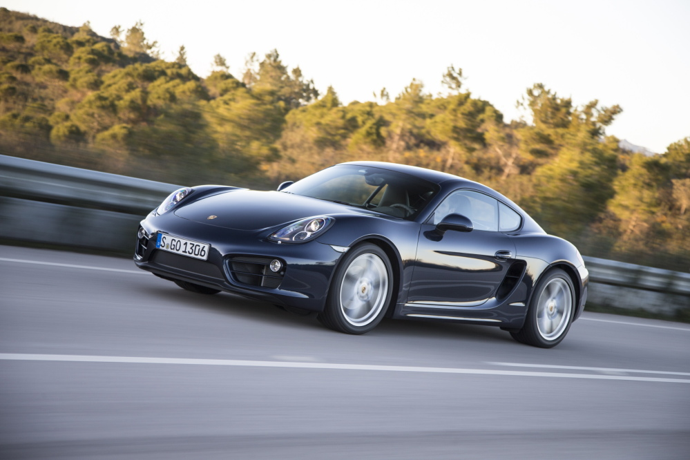 This undated photo provided by Porsche shows the 2014 Porsche Cayman. Porsche, Jaguar and Lexus were the best-performing brands in this year's J.D. Power quality rankings survey.