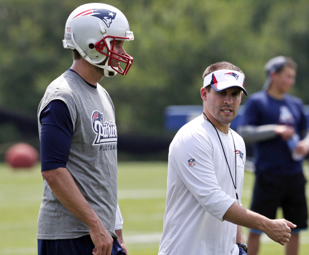 Patriots offensive coordinator Josh McDaniels, right, confers with Tom Brady during the Patriots' minicamp, which ends Thursday.