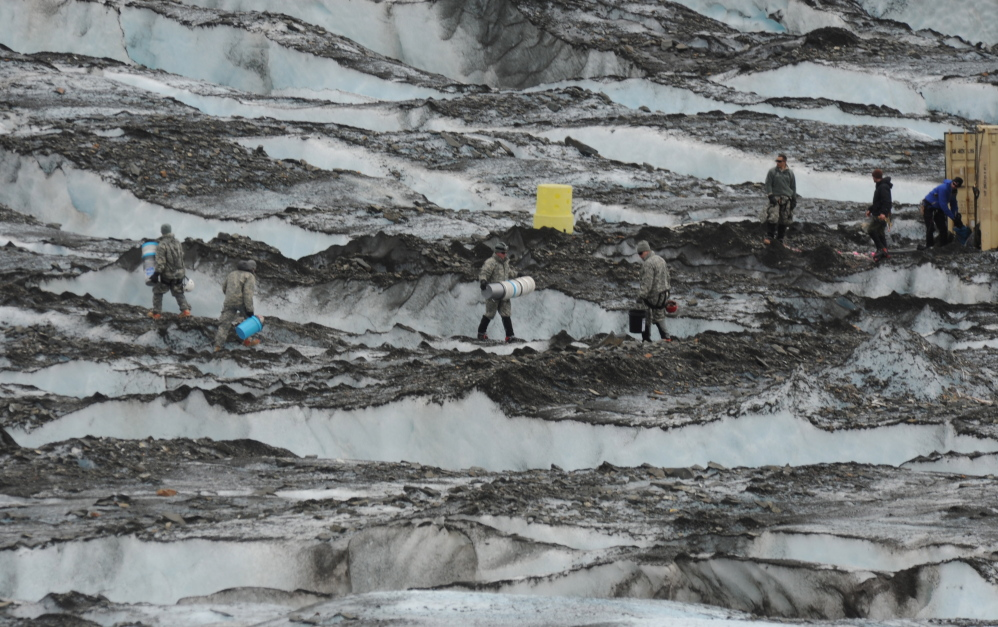 The Joint Task Force-Alaska Team from Joint Base Elmendorf-Richardson and Fort Wainwright recovers debris in 2012 on Colony Glacier near Anchorage, Alaska. The military says the remaining 35 service members have not yet been recovered.