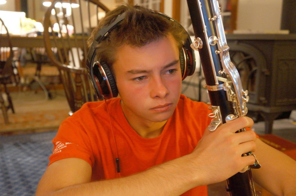 Benjamin Lamontagne, who planned to study music, holds his bass clarinet.