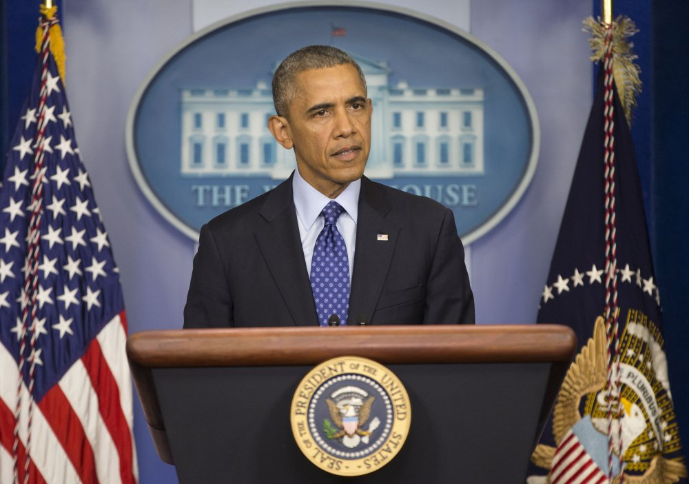 President Barack Obama speaks to members of the media about the situation in Iraq on Thursday at the White House.