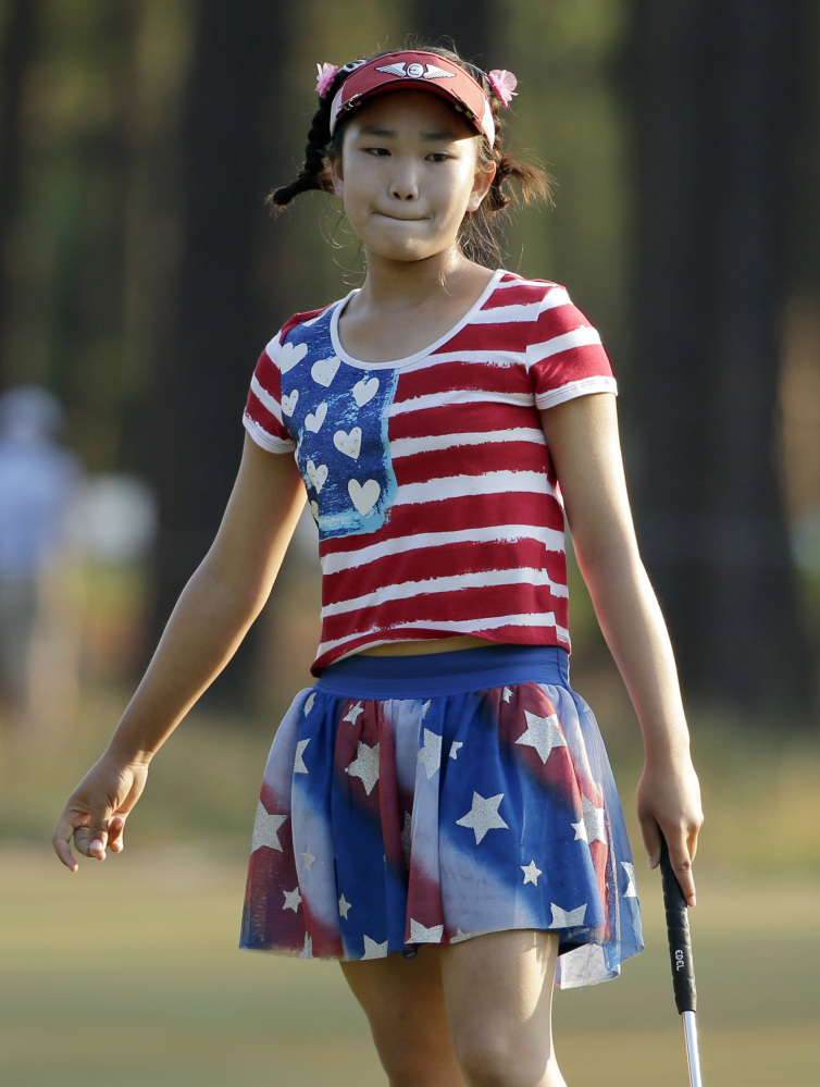 Lucy Li reacts to her putt on the 11th hole during the first round of the U.S. Women's Open golf tournament in Pinehurst, N.C., Thursday, June 19, 2014.