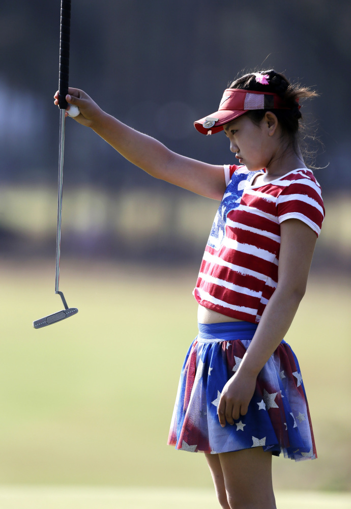 Lucy Li lines up a putt on the 13th hole during the first round of the U.S. Women's Open golf tournament in Pinehurst, N.C., Thursday, June 19, 2014.