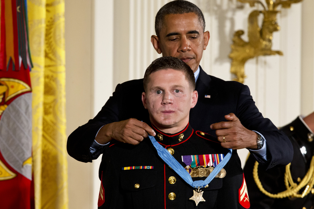 "President Obama awards retired Marine Cpl. William ""Kyle"" Carpenter the Medal of Honor for conspicuous gallantry Thursday in the East Room of the White House."