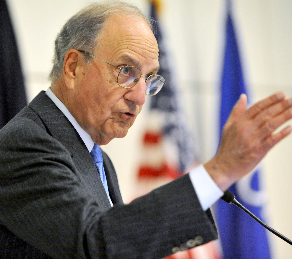 Former U.S. Sen. George Mitchell speaks at Colby College earlier this year. He says college students need mentoring as well as money to complete their degrees.