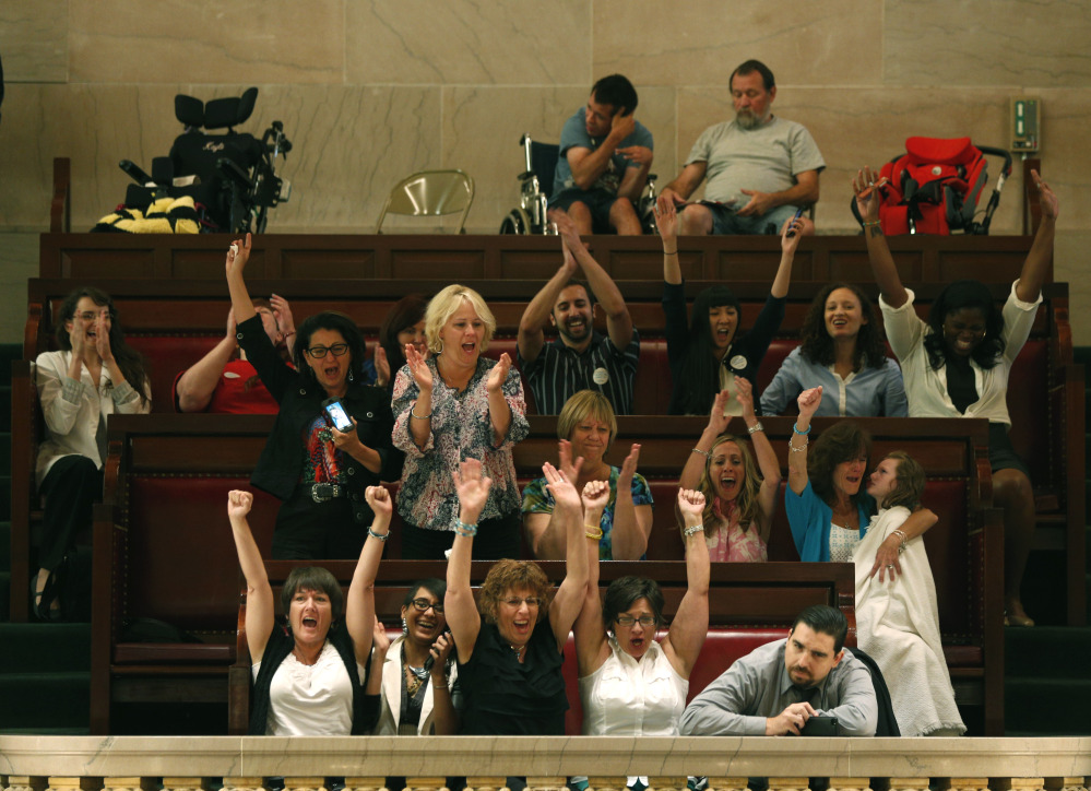 Onlookers in the gallery celebrate after the New York Senate voted to legalize medical marijuana in Albany on Friday.