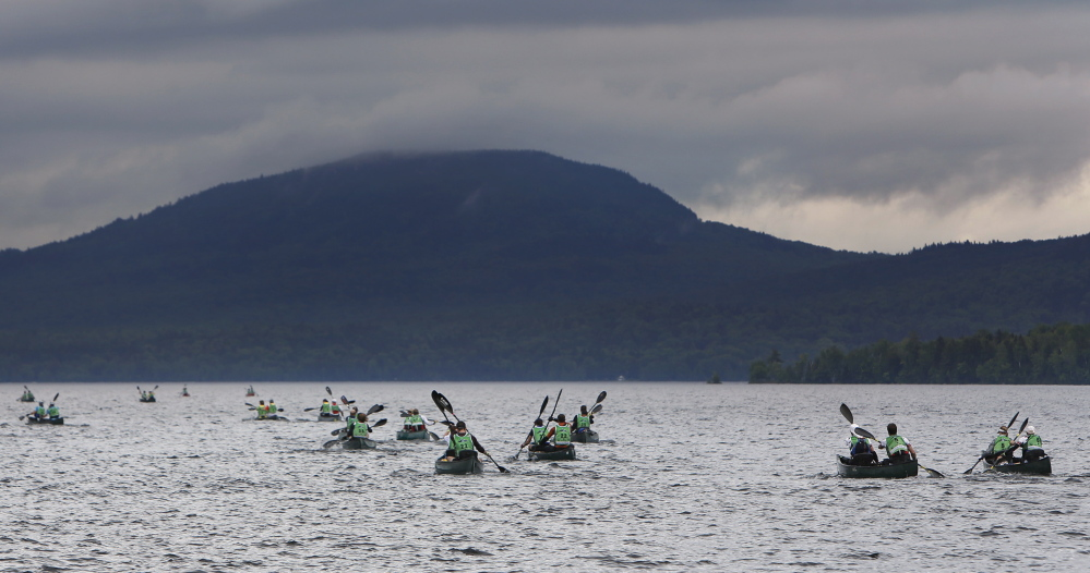 Teams paddle across Moosehead Lake toward Little Kineo Mountain at the start of the 200-mile, four-day test of endurance.