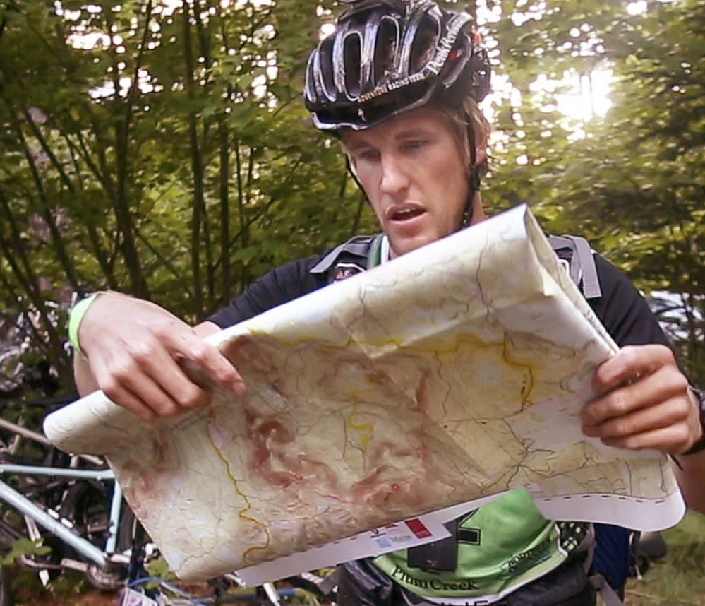 The longest journey begins with, well, a look at the map, as Staffan Björklund prepares for a 45-mile bicycle ride with his team this past Wednesday.