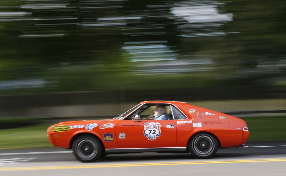 Marc Perlman of New Fairfield, Conn., driving a 1969 American Motors AMX, takes part in the Great Race road rally on Saturday. Officials say part of the challenge is following the instructions to win the race; the other challenge is finishing the race without any major mechanical breakdowns.
