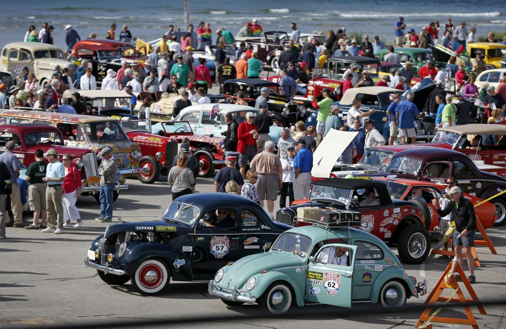 Hundreds of spectators crowd a parking lot at Ogunquit Beach to view participating cars before the start of the Great Race road rally on Saturday in Ogunquit.