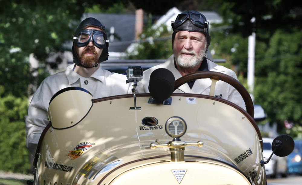 Navigator Chris Clark, left, of Ansonia, Conn., and driver Frank Buonanno of Newtown, Conn., take part in the Great Race on Saturday. Participants left Maine Saturday morning on a nine-day road rall  to Florida. The event, which launched in 1983, is a time/speed/distance rally with each driver and navigator being judged on how well they follow precise instructions that detail every move down to the second.